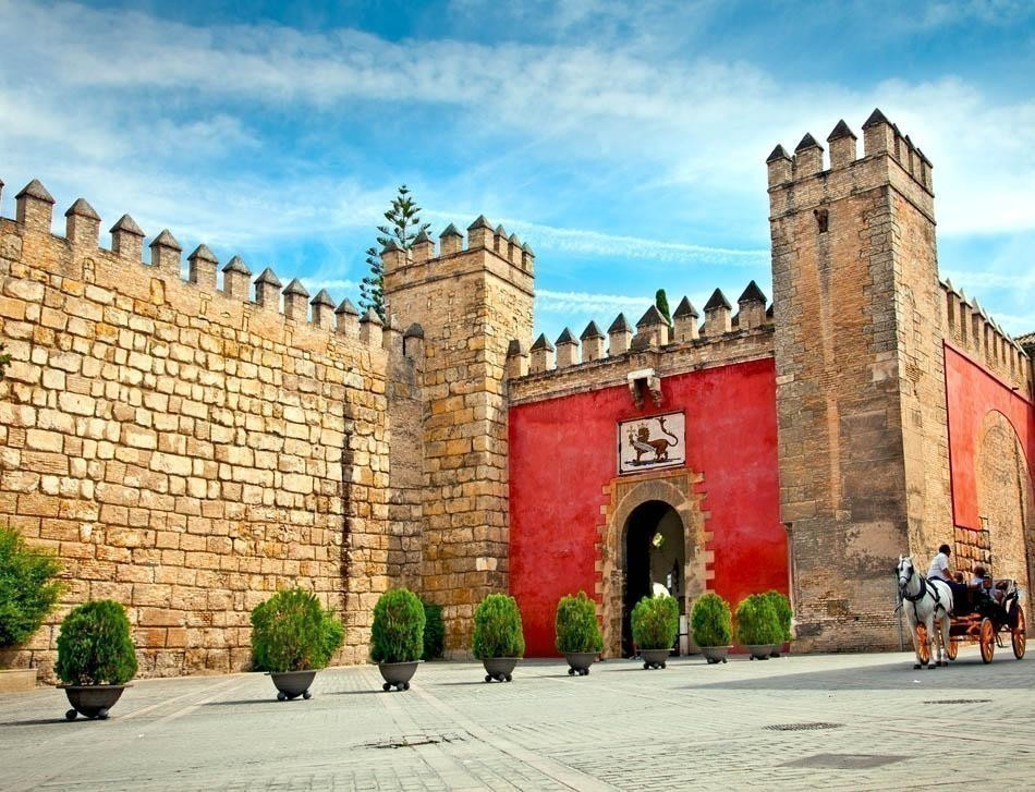 Gate to Real Alcazar Gardens in Seville. Andalusia | Spain Travel Guide
