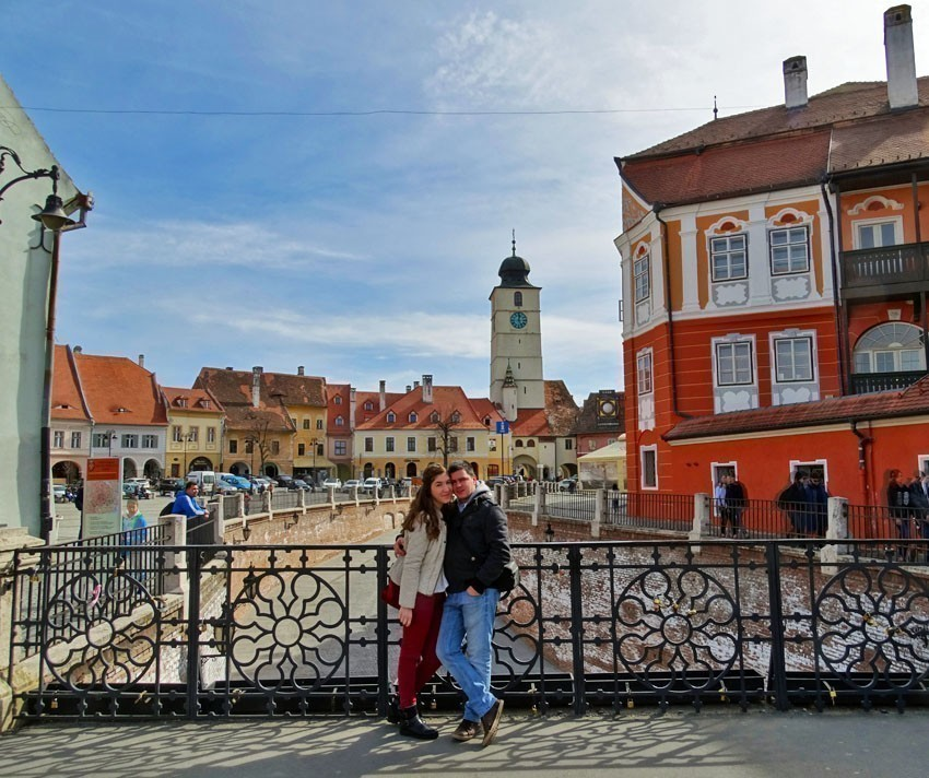 Standing on the beautiful bridge of Lies in Sibiu | 5 Reasons Why Romania is the Country Every Traveler Needs to Visit