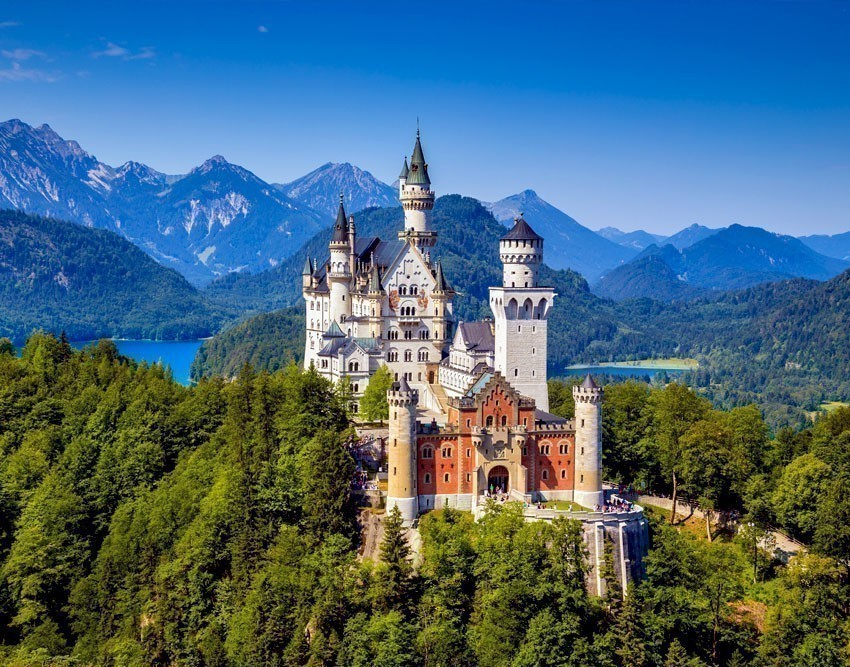 Reclusive King Ludwig's personal refuge, Schloss Neuschwanstein or Neuschwanstein Castle is a romantic mediaeval castle which is perched beautifully on the mountaintop in southwest Bavaria | Germany Travel Guide