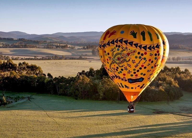 A sunrise hot air balloon flight over the Yarra Valley in Victoria, Australia | 10 Best Hot Air Balloon Rides Around The World