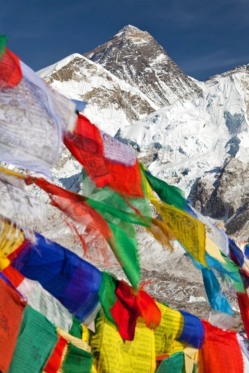 View of Mount Everest with buddhist prayer flags from Kala Patthar, Nepal | TOP 10 Places To Travel in May