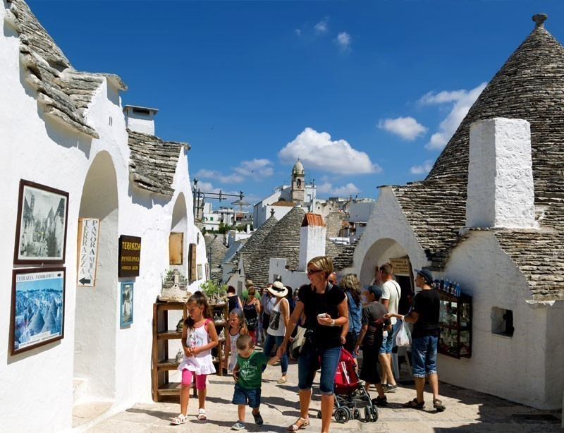 Stroll among Trulli houses in Alberobello. The Trulli of Alberobello is a UNESCO World Heritage site | 10 Spectacular Places to Visit Before They Become Famous