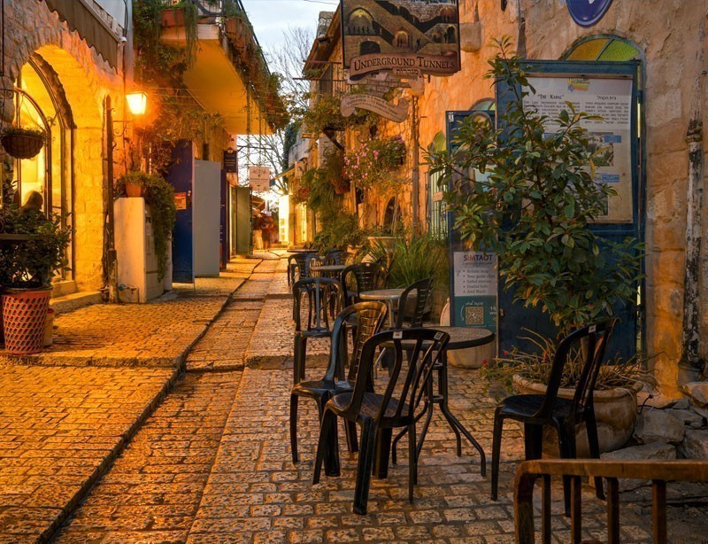 Sunset scene in an alley in the Jewish quarter, with local businesses, in Safed (Tzfat), Israel | 10 Spectacular Places to Visit Before They Become Famous