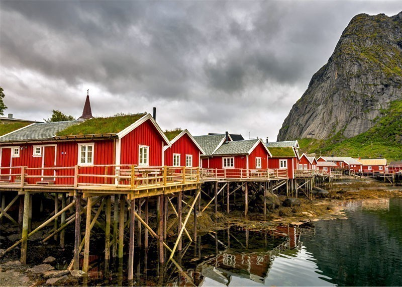 Typical red fishing huts called Rorbu in Reine on Lofoten islands | 10 Top-Rated Tourist Attractions in Norway
