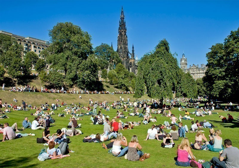 People relaxing on a sunny day in Princes Street Gardens, Edinburgh, Scotland   What to Do in Edinburgh in 3 Days