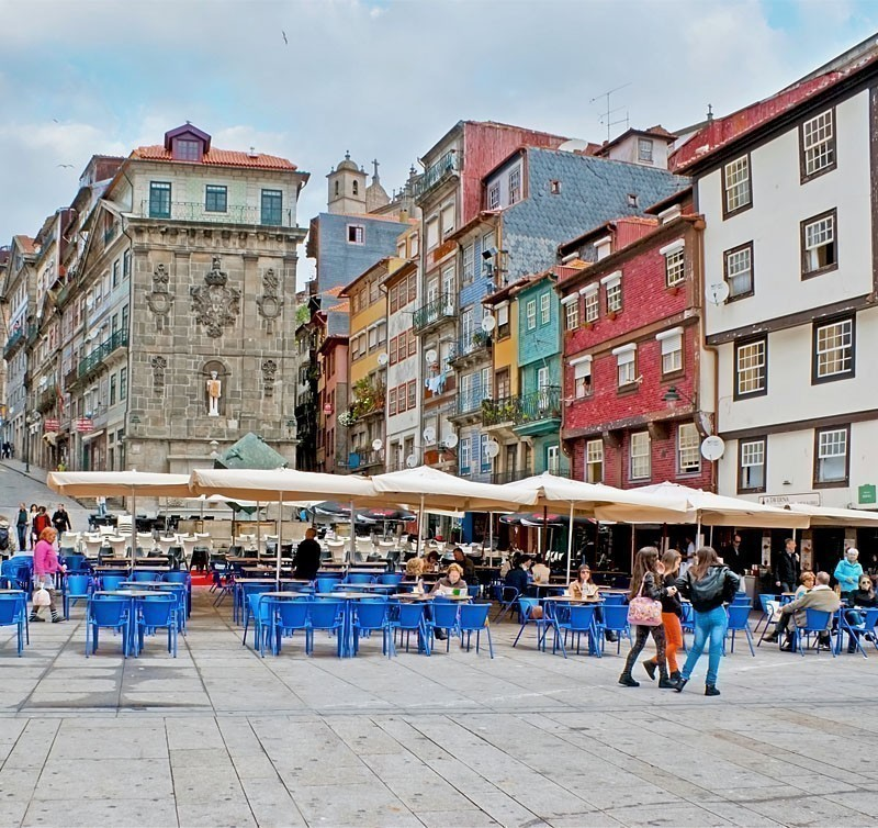 Ribeira Square in Porto, surrounded by colorful houses and beautiful cafes | What to Do in Porto in 3 Days