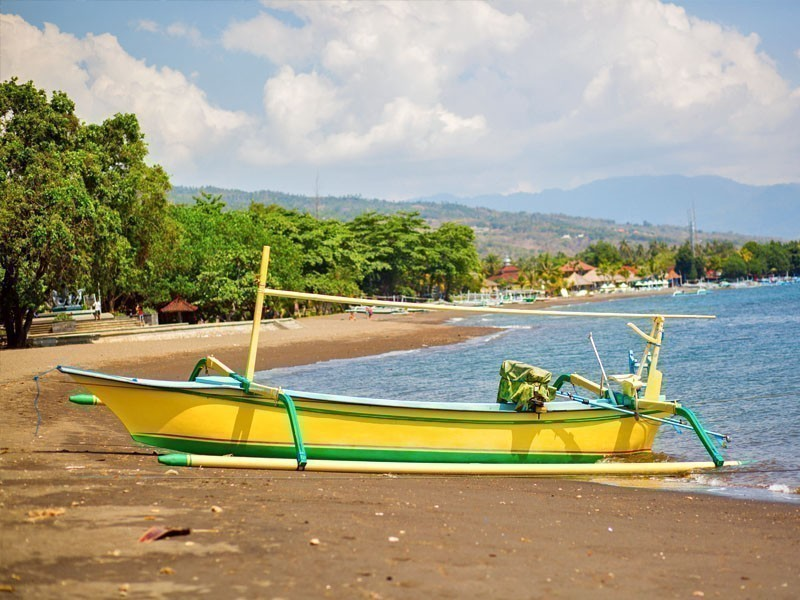 Lovina, the largest resort in the north of Bali, famous for its black, volcanic sand | 10 Amazing Places to Visit in Bali
